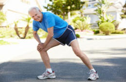 Image of mature man stretching for a run - click for more information about total knee surgery