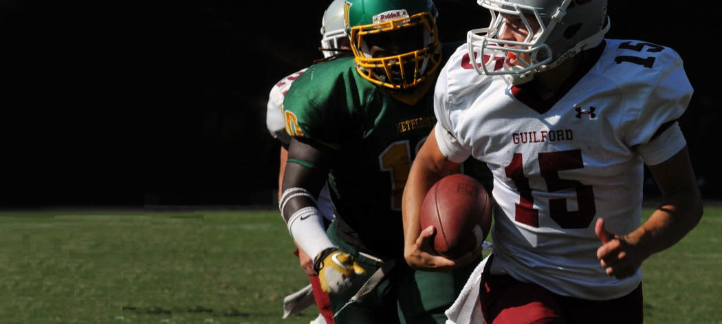 Background image of Guilford College football player